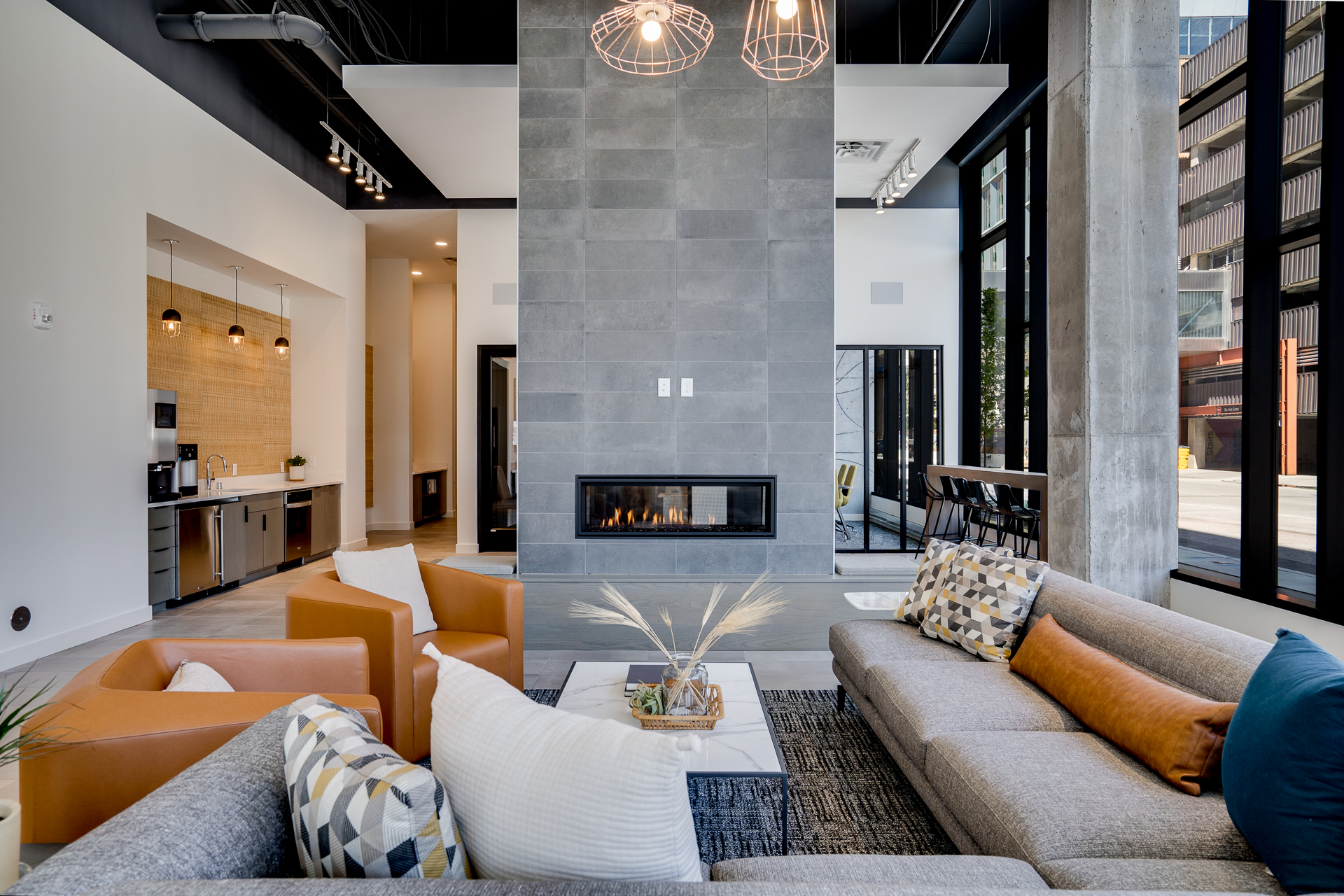 sora lobby with fireplace and couches